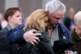 Fallen Denver Police officer Donald Young's wife Kelly Young, cq, cries during the Rifle Salute as...