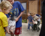 Evergreen, Co.  4/28/04.  Students at  Montessori School of Evergreen carry heavy bags of pennies...