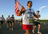 Raef Guirges (cq), of Torrance Calif., runs at the start of the Post-News Colorado Colfax Marathon...