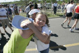 Ken Manley (cq), 50, left, gets a hug from proud daughter Juliet Manley (cq), 8, right after Ken...