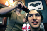 (DENVER, Colo., March 17, 2005) Ryan Martinez, 25 from Littleton, gets his head shaved by Susan...