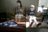 Tanner Segura, 8 sits on the sofa with his mother, Lisa Gramling, in their Castle Rock  home...