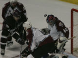 JPM052   Colorado Avalanche goalie Jose Theodore has the puck bounce in front of him as Avalanche...