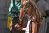 Kelsey Young, 6 years old, holds her mom's hand, Kelly Young (cq),  while her mom talked to the...