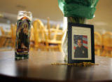 A candle, flowers, a crucifix and a photo of Denver Police detective Donald Young were on display...