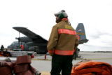 Caleb Berry, cq, Modular Airborne Fire Fighting System (MAFFS) Airborne Manager watches the turn...