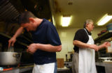 (Vernal, Utah) Jonathan Swain, 21, cooks in the kitchen with his father, Dee Swain, right, at the...