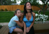 Kailya Goodman, CQ, holds tighly onto her mother, Christine Goodman, CQ, during a Mothers Day...