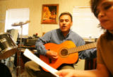 "Samuel Hernandez, cq, 47, and his wife Rosalia Hernandez, cq, 42, sing ""The Light of..."