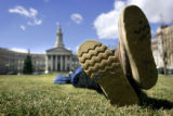(DENVER, Co. - SHOT 3/17/2005) Samuel Lopez, 37, of Denver kicks back on the lawn in Civic Center...