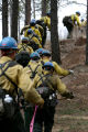 Pike Hotshots crew walk to a simulated fire, to established a fire line Tuesday, May 9, 2006 at...
