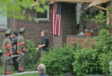 Denver fire crews attend to the scene of a fire at 501 S. High Street Tuesday afternoon May 9,...