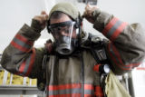 Denver Fire Technician Derrick Delgado (cq) demonstrates how a respirator works at Station 1 in...