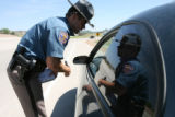 Colorado State Patrol Trooper Dan Bozung (cq) makes a traffic stop of a vehicle on I-25 near...
