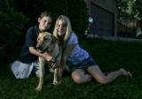 Ryan Rambo (cq), 8, LEFT, and Chelsea Bennett (cq), 13, middle, with Bennett's yellow Labrador...
