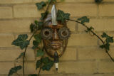 A sculpture hangs on the north side of the garage. In Denver, Colo. on 5/10/06 Jennifer Bater has...