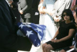 JPM053  Louise Montoya, right, watches the flag from her husband Denver firefighter Lt. Rich...