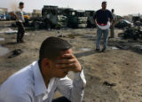 (NYT5) BAGHDAD, Iraq -- May 16, 2006 -- IRAQ-5 -- A man weeps at the site of a bombing in Baghdad,...