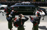 The ceremonial bagpipers salute after the casket was carried into the Cathedral of the Immaculate...