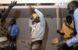 "Kur Anyieth Kur (cq) (far right), a ""Lost Boy"" refugee from southern Sudan, performs..."