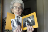 Eleanor Keller (cq) holds photos of her brother at her Denver home Thursday May 18, 2006. She took...