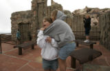 Zoe LaPorte,(cq) 12 from Cal. shares a warming hug from Claire Carlin,(cq) 7 (l-r) at the top of...