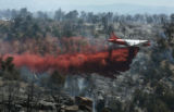 A heavy airtanker fights the Black Ridge Wildfire  on the Southern Ute Reservation , south of...