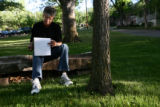 Frank Shorter (cq), of Boulder, goes over his notes outside the Chautauqua Park Community House in...