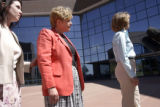 The Arapahoe County District Attorney Carol Chambers (middle), Assistant District Attorney Leslie...