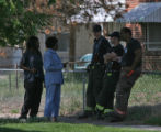 Denver firemen talk to residents about a house fire at 4306 Thomson Ct. in Denver on Sunday...