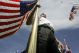 Ron Davies (cq) Commander VFW Post 9644, Englewood, holds the VFW's American flag during...