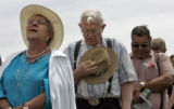 (L-R) Sylvia Roybal (cq) from Denver, Harold Topping (cq) from Denver, a WW2 Army Veteran of the...