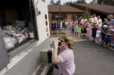 Evergreen, Co.  4/28/04.  Students at  Montessori School of Evergreen load bags of pennies onto an...
