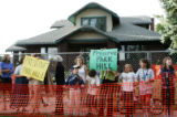 JPM055  Several dozen protesters hold signs and chant slogans in front of 5335 Montview Blvd., in...