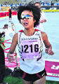 Nikie Takanaka makes her way across the finish line as the winner of the women's Citizen Race of...