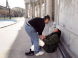 (DENVER, Co. - SHOT 3/16/2005) A woman tries to help her friend up after the pair finished off a...