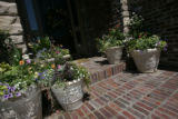This Greenwood Village home was landscaped by Chad Brunette's company and has large pots in front...
