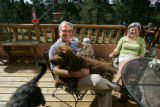 EJ158  CBS4's weather man Larry Green relaxes at his home in Genessee with his wife, Amy, and...