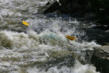 A raft from Nova Guides gets submerged in the Dowd Chutes Monday afternoon, May 15, 2006, on the...