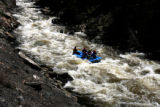 A raft from Nova Guides works its way through the Dowd Chutes Monday afternoon, May 15, 2006, on...