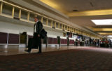Passenger Tom Schmidt (cq) walks past unused ticket check-in counters at the Colorado Springs...