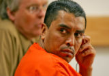 Damion Campos listens to a court appointed interpreter while turning to look at the Martinez...