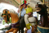 Shannon Shankin (cq), 33, sits on one of his favorite rides--the old carousel--at Six Flags Elitch...