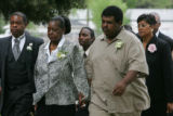 Aaron Thompson, far right,  walks into the Mount Gilead Baptist Church for Shely Lowe's funeral on...