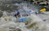 A raft from Breckenridge White Water Rafting gets submerged on the Eagle River Monday afternoon...
