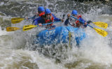 A raft from Breckenridge White Water Rafting fights its way through a wave on the Eagle River...