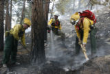 ( L-R) Wildland firefighters Robert Bertram (cq) with Florissant Volunteer Fire and Rescue, John...