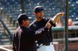 (DENVER, CO. APRIL 3, 2005) (Lt. to Rt.) Colorado Rockies Baseball Team Coach Mike Gallego (CQ....