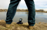 (THORNTON Colo., March 20, 2005)  Richard Gill, from Thornton, uses a portable fish finder to...