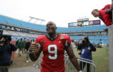 STATE14.SP.123105.EDH   NC State's Mario Williams walks off the field after State defeated South...